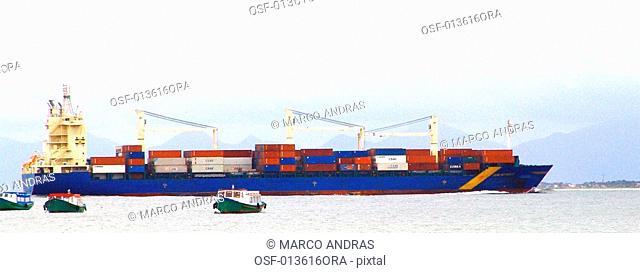 some boats and ships sailing at sea port