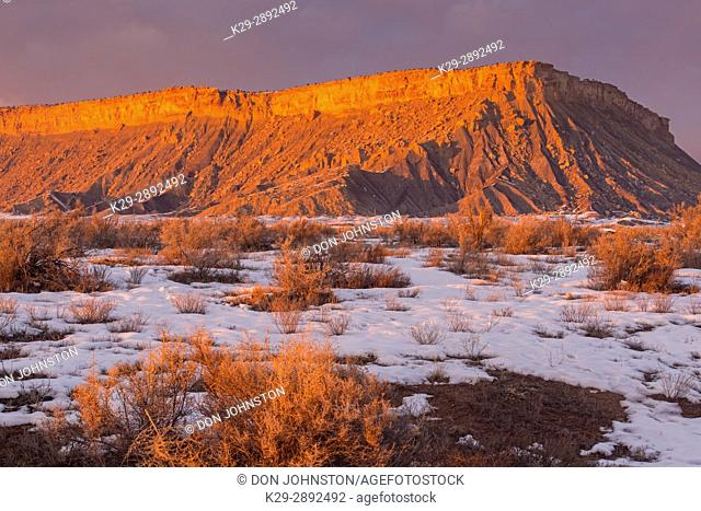 Evening light on Mojave Desert buttes in winter, Thompson Springs, Utah, USA
