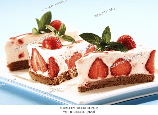 Piece of strawberry-cream-cheese cake on plate