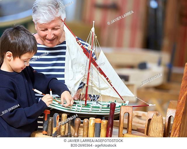 Grandfather and grandson, Building model sailboat, Whaleship, Pasaia, Gipuzkoa, Basque Country, Spain, Europe