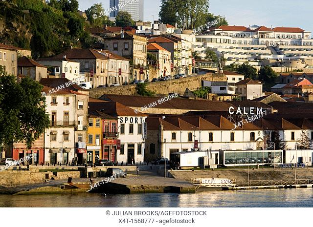 Closely packed buildings on the waterfront in Porto with Port wine warehousing