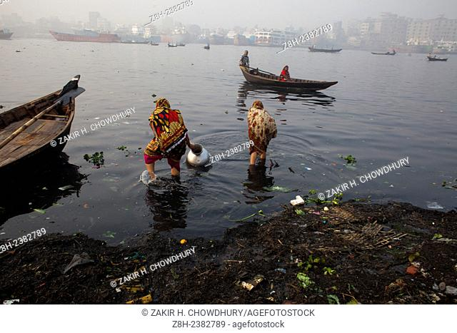 Women collected polluted water from Buriganga river for their daily needs