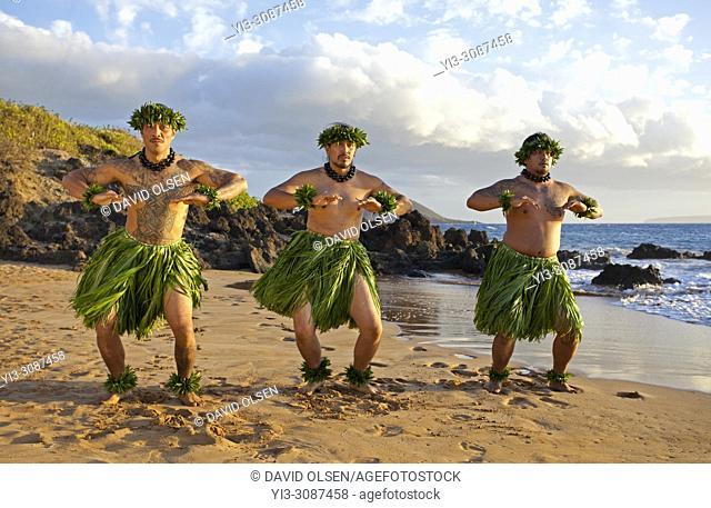 Three hula dancers at sunset at Wailea, Maui, Hawaii