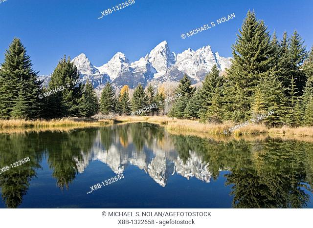 Reflected light on water from the Grand Teton Mountain Range, outside of Jackson Hole, Wyoming  This image was shot from the Schabawacker Landing on the snake...