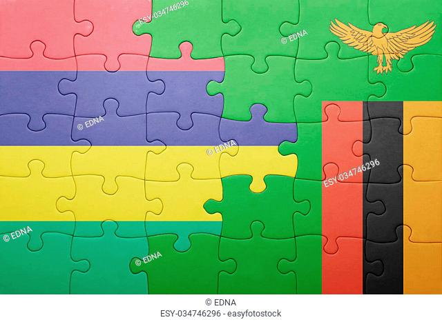 puzzle with the national flag of zambia and mauritius . concept