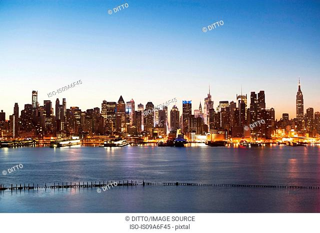 Manhattan skyline and waterfront at dusk, New York City, USA