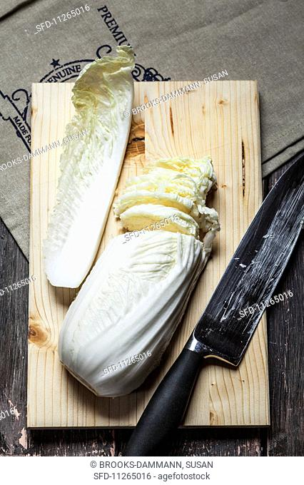 Chinese cabbage, sliced, on a chopping board