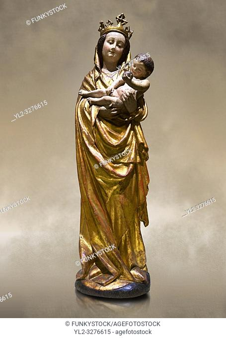 Gothic wooden statue of Madonna and Child from Bohemia, circa 1530-1540, tempera and gold leaf on wood,. National Museum of Catalan Art, Barcelona, Spain