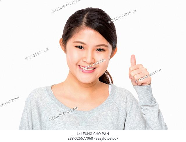 Young woman showing with thumb up