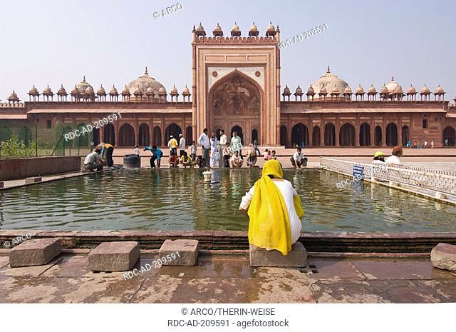 Indian pilgrims making their ritual ablution, courtyard, Jami Masjid Mosque, Fatehpur Sikri, Uttar Pradesh, India, Dargah Mosque