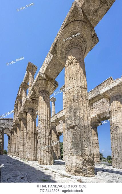 inner Doric columns at Neptune temple, shot in bright summer light at Paestum, Salerno, Campania, Italy