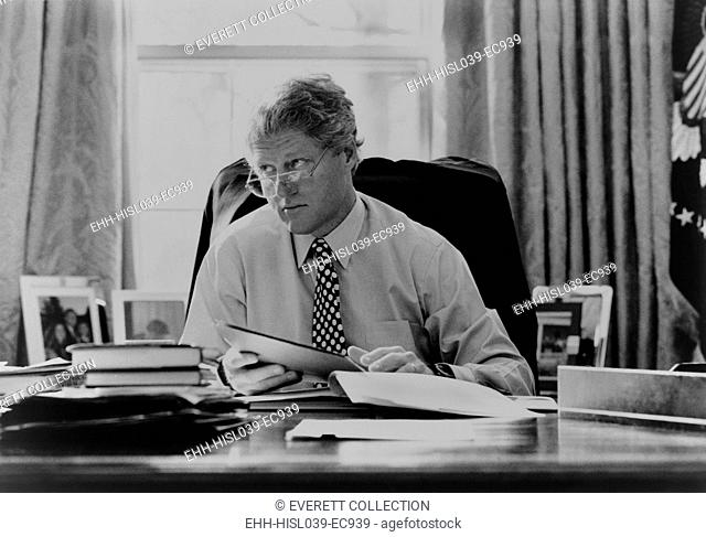 Informal portrait of President Bill Clinton at his desk in the Oval Office. 1993. (BSLOC-2015-2-187)