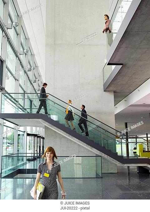 Businesspeople walking in office building