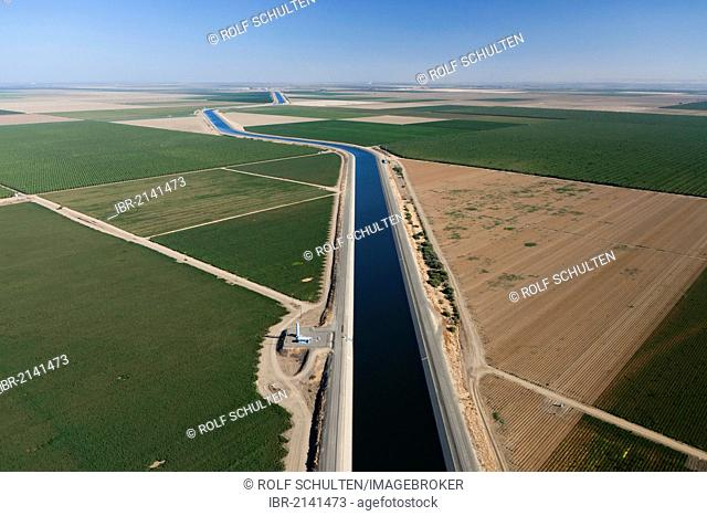 Aerial view of farmland in Central Valley with an irrigation canal which is part of California's Aqueduct, a system of canals, tunnels and pipes
