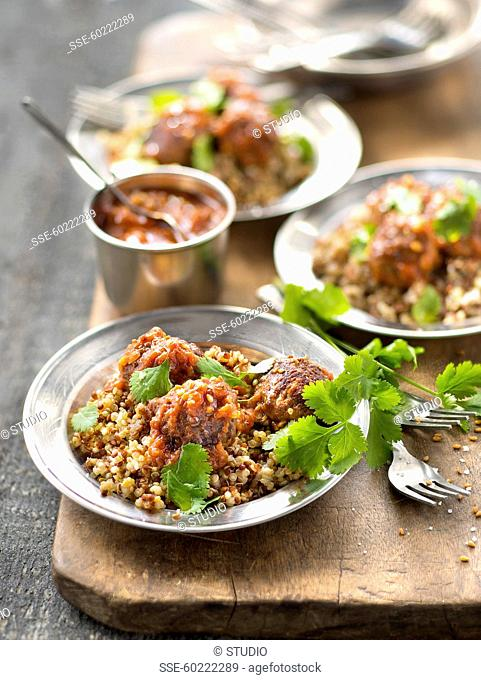 Beef meatballs in tomato sauce with quinoa and coriander