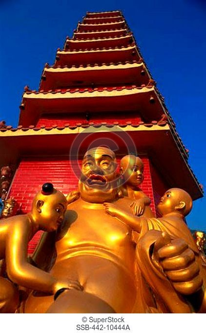 Low angle view of statues of Laughing Buddha in front of a temple, Ten Thousand Buddhas Monastery, Sha Tin, New Territories, Hong Kong, China