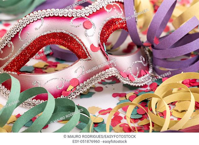 carnival venetian mask with confetti and serpentine streamers