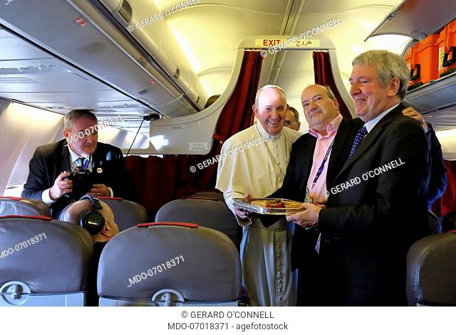 Pope Francis offers a cake on the occasion of the birthday of two journalists: Philip Pullella and Gerard O'Connell. Flight Rabat-Rome, March 31st, 2019