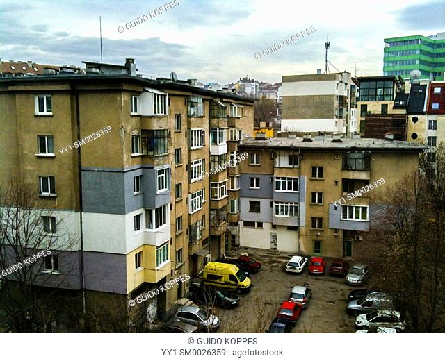 Sofia, Bulgaria. Inner court yard of residential buildings inside a down town neighbourhood with cars parked