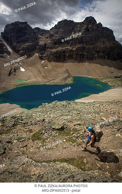 View of person hiking near lake in Canadian Rockies, Yoho National Park, Alberta, Canada