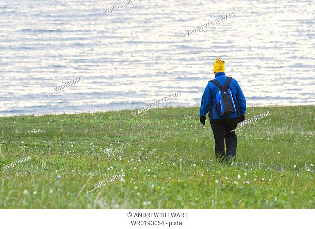 Tourist Female hiker walking, exploration on Bering Islands Bering Sea Russia, Asia