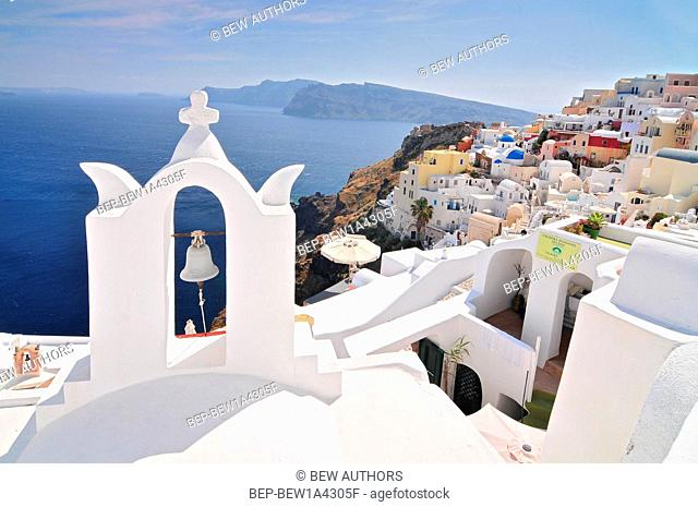 Santorini landscape with white greek bell tower and sea in the background - Oia Town, Santorini Island, Cyclades, Greece