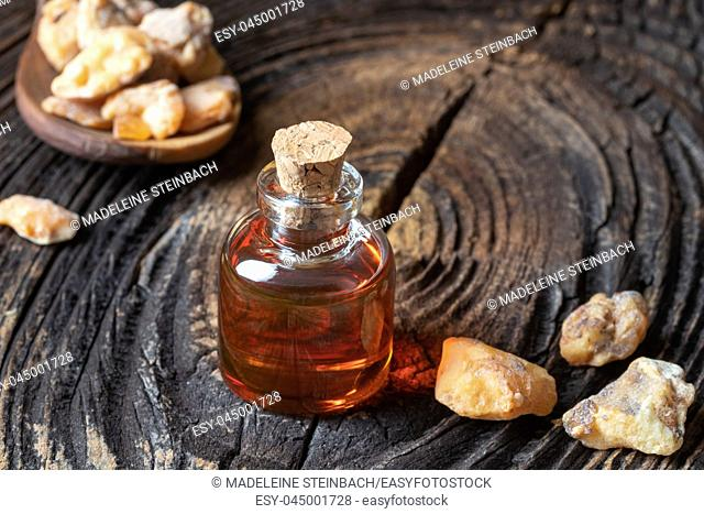 A bottle of styrax benzoin essential oil and resin