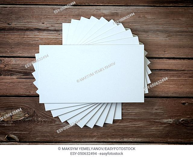 White blank business cards mockup template on the wooden table. 3d illustration