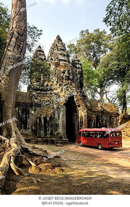 Bus in front of the north gate of Angkor Thom, Avalokiteshvara face tower, Angkor Thom, Siem Reap, Cambodia