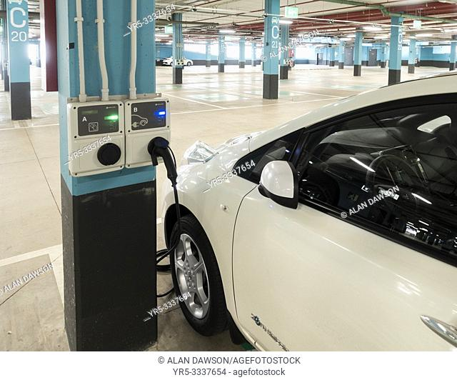 Electric car charging point in shopping centre car park on Gran Canaria, Canary Islands, Spain