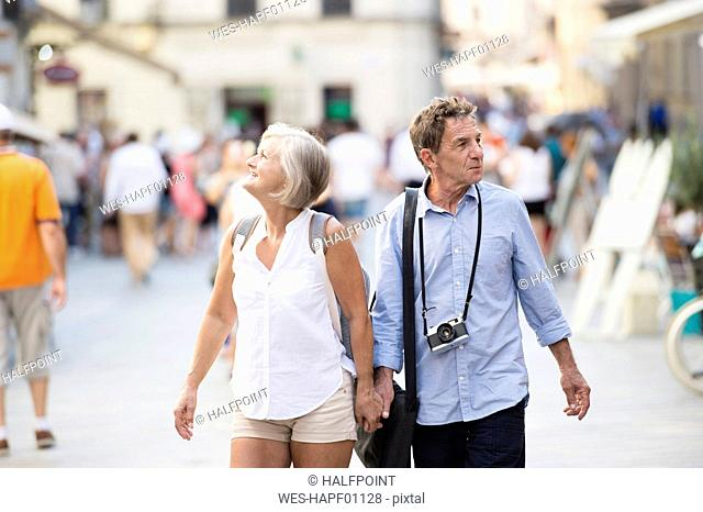Senior couple on city trip