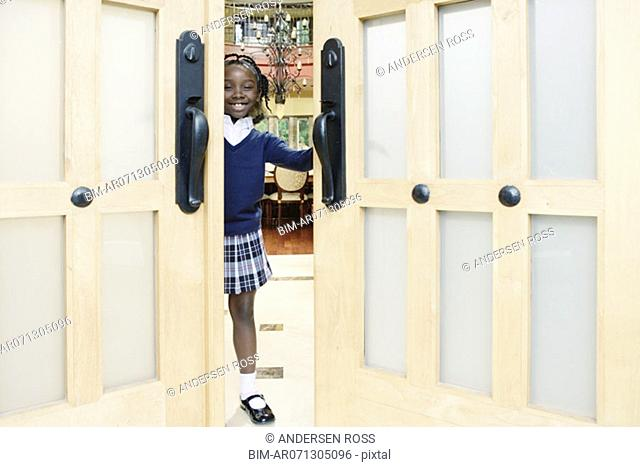 Girl in doorway to house