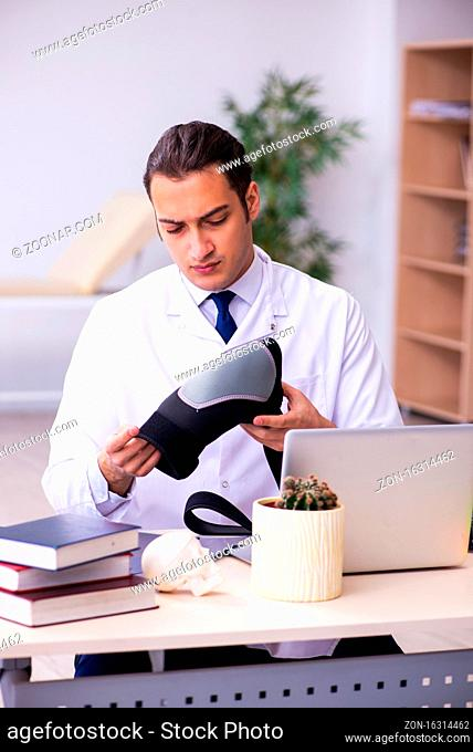 Male doctor traumatologist working in the clinic