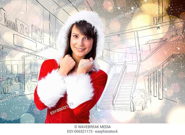 Composite image of cute brunette in santa claus smiling at camera