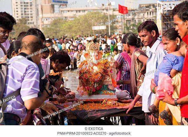People at the immersion ceremony of Lord Ganesha, Mumbai, Maharashtra, India