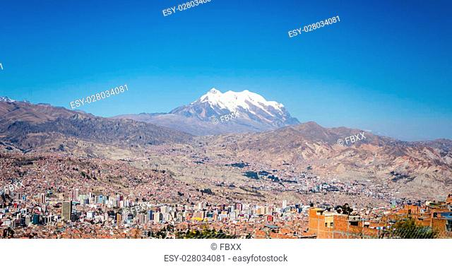 Cityscape of La Paz from El Alto, Bolivia, with the stunning snowcapped mountain range in the background