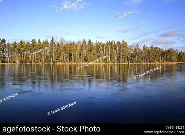 Small rural lake Sorvasto in Salo, Finland, thinly ice-covered on a sunny winters day with brilliant blue sky. January 25, 2020