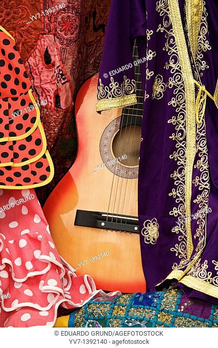 Between Moorish flamenco guitar and flamenco dresses  Córdoba's shop