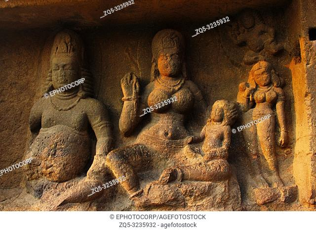 Yaksha Jambhala sits with his wife, Hariti, who holds one of her five hundred children on her lap, Cave 8, Ellora Caves, Aurangabad, Maharashtra