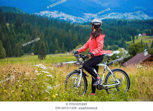 Woman Mountain Biking Field Stock Photos And Images Age