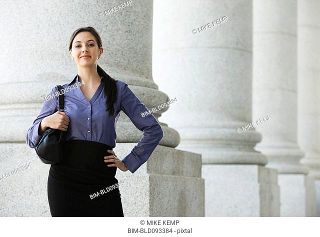 Caucasian businesswoman standing outdoors