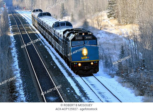 A Via Rail passenger train waiting at a rural siding near Hinton Alberta Canada