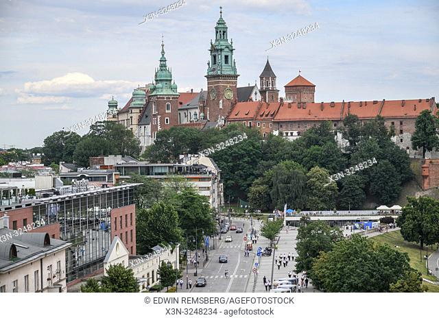 Wawel Royal Castle on the hill looms over its modern counterparts in Krak—w, Lesser Poland Voivodeship, Poland