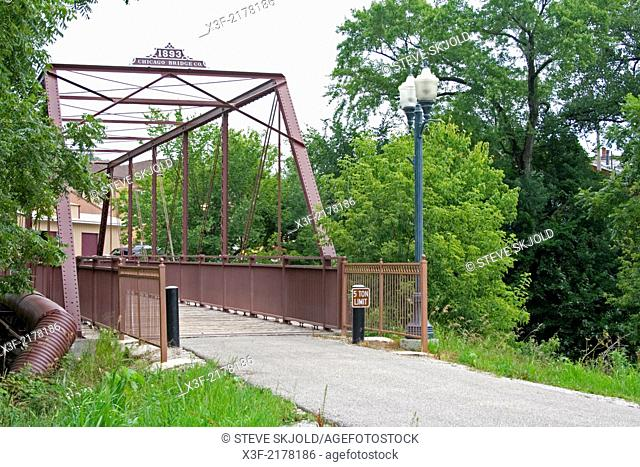 Historic Root River State Trail railroad bridge crossing the Root River leading to downtown area. Lanesboro Minnesota MN USA