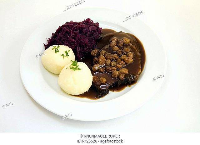 Rhenisch Sauerbraten (marinated beef roast) with potato dumplings and red cabbage