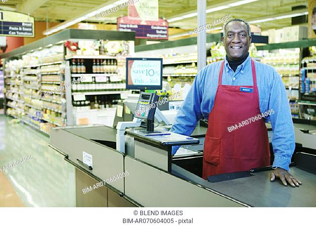 Portrait of cashier at store