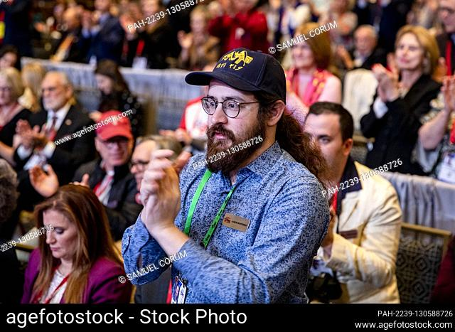 OXON HILL, Md. - FEBRUARY 27: A man gets out of his seat to applaud during a speech from U.S. Vice President Mike Pence during the Conservative Political Action...
