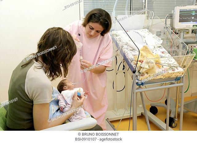 ENTERAL FEEDING Photo essay at the hospital of Meaux 77, France. Department of neonatology. The pediatric nurse is holding in her arms a premature child