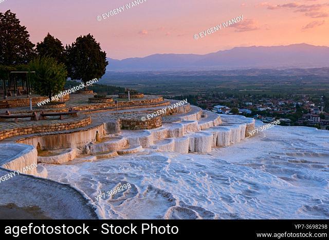 White travertine basins at sunset in Pamukkale, Turkey