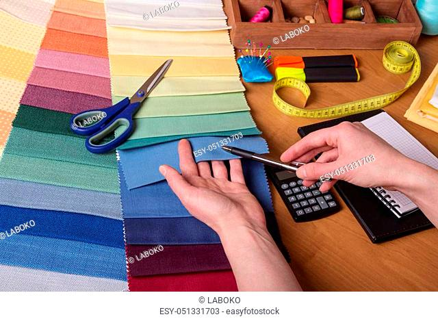Choice of fabric for sewing, sewing accessories on work table